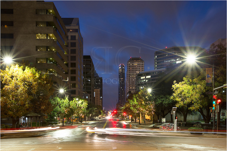 From the gate of the state capitol, this is the view down South Congress Avenue on an early morning.. The high rise in the distance is the well known and tallest building of Austin, Texas, the Austonian.