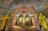 TX0123-D. Painted Buddha statues and intricate murals in the Golden Temple of Dambulla (also called the Dambulla Cave Temple), a UNESCO World Heritage site dating back to the 1st century BC. This cave monastery is located in the central part of the country. It has five sanctuaries and has been a sacred pilgrimage site for 22 centuries. Sri Lanka.<br /> Photo Copyright © Brandon Cole. All rights reserved worldwide.  www.brandoncole.com