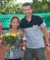 August 9, 2014, Netherlands, Rotterdam, TV Victoria, Tennis, National Junior Championships, NJK,  Prize giving, Richard Krajicek with Daevinia Achong, runner up  girls 14 years<br /> Photo: Tennisimages/Henk Koster