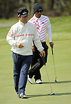JEJU, SOUTH KOREA - APRIL 23:  Thongchai Jaidee (R) of Thailand and Y.E. Ynag of Korea wait to putt on the 13th green during the fog-delayed Round One of the Ballantine's Championship at Pinx Golf Club on April 23, 2010 in Jeju island, South Korea.  Photo by Victor Fraile / The Power of Sport Images