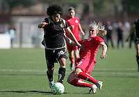 Eriko Arakwa (30) and Becky Sauerbrunn (22). Washington Freedom defeated FC Gold Pride 4-3 at Buck Shaw Stadium in Santa Clara, California on April 26, 2009.