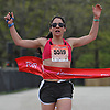 Jessica Petrina, 36, of Selden wins the 5K race female competition during Long Island Marathon Weekend at Eisenhower Park on Saturday, May 5, 2018.