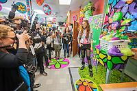 "Latin female singer Leslie Grace appears at the Happy Family Laundromat in the Bronx borough of New York on Friday, May 16, 2014 at a promotional event for Procter & Gamble's Gain ""Flings"" detergent pods. Procter & Gamble redecorated the laundry in a 60's ""flower power"" motif with the help of students working with the Portraits of Hope non-profit. Portraits of Hope works with children in hospitals and previously used the same motif to cover NYC taxis. Leslie Grace (Martinez) is a19 year old bilingual Latin recording artist.  P&G has decorated six laundromats throughout the city in this fashion. (© Richard B. Levine)"