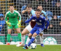 Leicester City's James Maddison under pressure from Burnley's James Tarkowski<br /> <br /> Photographer Rich Linley/CameraSport<br /> <br /> The Premier League - Burnley v Leicester City - Saturday 16th March 2019 - Turf Moor - Burnley<br /> <br /> World Copyright © 2019 CameraSport. All rights reserved. 43 Linden Ave. Countesthorpe. Leicester. England. LE8 5PG - Tel: +44 (0) 116 277 4147 - admin@camerasport.com - www.camerasport.com
