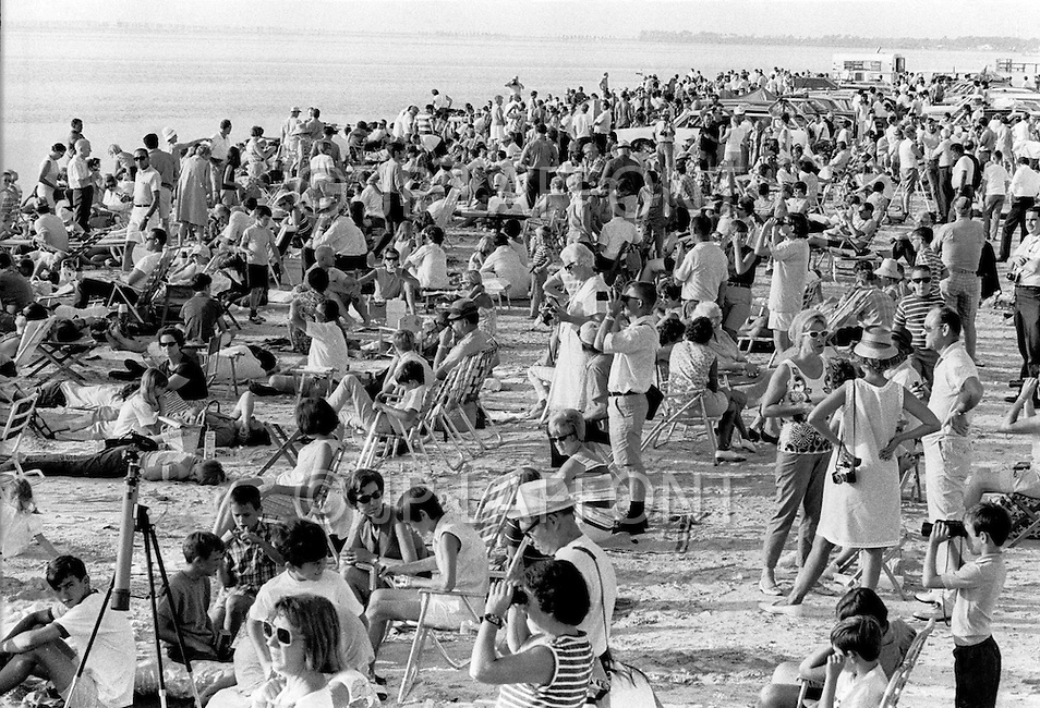 July 16, 1969., Cape Kennedy, Florida, USA --- Crowds Waiting to Watch Launch of Apollo 11 at Kennedy Space Center --- Image by © JP Laffont