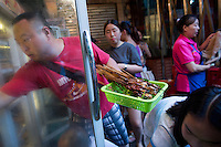 Patrons pick ingredients for their hotpot from fridges holding a variety of vegetables, meats, and tofu, at He Wang Shi Chuan Chuan Xiang Huo Guo, a skewer-style hotpot restaurant popular with locals on Tiyu Road in Chongqing, China. Individual servings of meat, vegetables, and tofu, are placed on skewers which diners choose to add to their table's hotpot. The restaurant, which has many favorable online reviews, often has a long wait for tables.