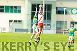 A clean catch in the air by Rob Ó Sé from An Ghaeltacht as he fends off the challenge from Michael Wrenn of John Mitchels in the Intermediate Football Championship.