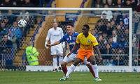 Anthony Stewart of Wycombe Wanderers & Gary Roberts of Portsmouth in action during the Sky Bet League 2 match between Portsmouth and Wycombe Wanderers at Fratton Park, Portsmouth, England on 23 April 2016. Photo by Andy Rowland.