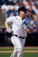 New York Yankees Erik Kratz (38) runs to first base during a Spring Training game against the Toronto Blue Jays on February 22, 2020 at the George M. Steinbrenner Field in Tampa, Florida.  (Mike Janes/Four Seam Images)
