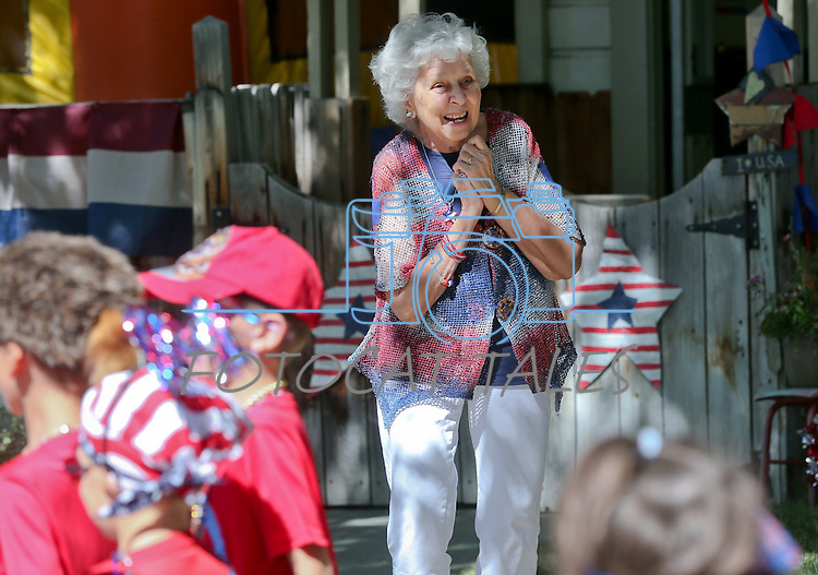Kinderland Nursery School founder Rosetta McFadden waves to her students as they march in the annual Kinderland Nursery School Fourth of July parade in Carson City, Nev., on Thursday, July 3, 2014.<br /> Photo by Cathleen Allison