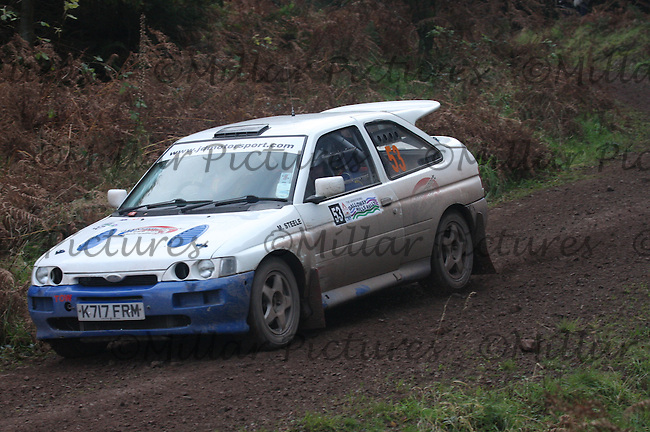 Darren Martin / Martin Steele in their Ford Escort Cosworth near Junction 6 in the R Earsman (Builders & Joiners) Special Stage 3 Dalbeattie of the Armstrong Galloway Hills Rally 2011 based at Castle Douglas on 30.10.11.