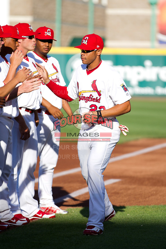 Thomas Pham (22) of the Springfield Cardinals high fives teammates after being introduced prior to a game against the St. Louis Cardinals at Hammons Field on April 2, 2012 in Springfield, Missouri. (David Welker/Four Seam Images)