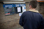 Matlock Town 0 Eastwood Town 3, 09/10/2010. Causeway Lane, FA Cup 3rd qualifying round. A fan examines a chalkboard sign inside the stadium advertising the team's for the FA Cup 3rd qualifying round tie between Matlock Town and Eastwood Town at Causeway Lane, Matlock. The visitors from Nottingham who play one division higher than Matlock won by three goals to nil to move to within one round of the FA Cup 1st round proper. The match was watched by 655 spectators. Photo by Colin McPherson.