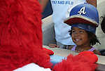 Archie plays with a fan at Greater Nevada Field in Reno, Nev., on Sunday, July 17, 2016.<br />Photo by Cathleen Allison