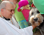 The Rev. Bill DeForest blesses &quot;Honey&quot; owned by Betty Chiswell at the annual Blessing of the Animals at St. Christopher's Episcopal Church Saturday Oct. 14,2006.(Dave Rossman/For the Chronicle)<br />