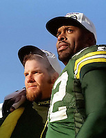"Green Bay Packers quarterback Brett Favre and defensive end Reggie White on the trophy presentation podium at the conclusion of the NFC Championship in which the Packers defeated the Carolina Panthers 30-13 on January 12, 1997. This was the first title game in Green Bay since the ""Ice Bowl"" in 1967."