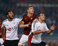 Leverkusen's Karim Bellarabi ,  AS Roma's Edin Dzeko   and Leverkusen's Giulio Donati  wait for ball  during the Champions League Group E soccer match between As Roma and  Bayer Leverkusen at the Olympic Stadium in Rome, November 04 2015