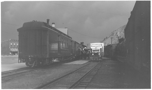 A twilight scene at the Durango depot showing workers transferring freight from the D&amp;RGW San Juan baggage car to a waiting RGS Goose.<br /> RGS  Durango, CO  Taken by Richardson, Robert W. - 7/4/1941