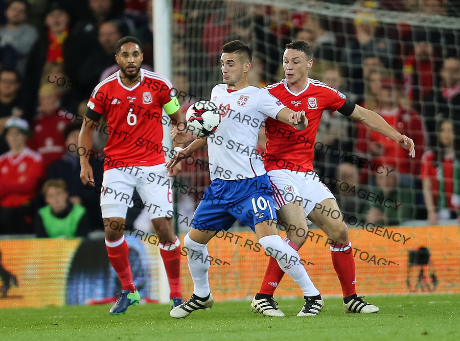 (copyright &amp; photo: STARSPORT)<br /> 12.11.16 - Wales v Serbia, FIFA World Cup Qualifier 2018 - Dusan Tadic of Serbia wins the ball from James Chester of Wales