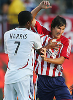 Real Salt Lake midfielder Atiba Harris (7) shoves Chivas USA midfielder Sacha Kljestan (16). CD Chivas USA beat Real Salt Lake 1-0 in a MLS game at the Home Depot Center in Carson, California, Sunday, August 26, 2007.