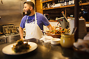 Durham, North Carolina - Friday October 30, 2015 - Isaac Shuman works in the kitchen at Mateo in Durham, NC.