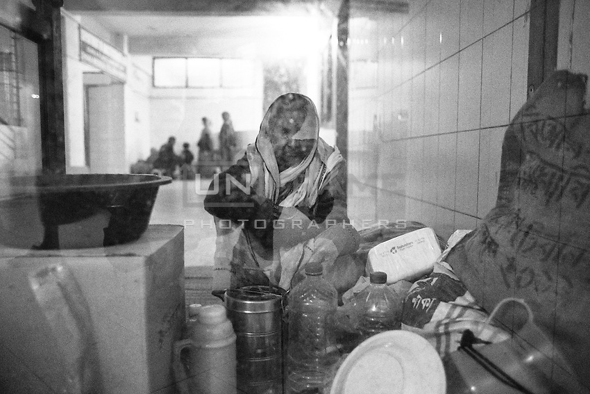 Relatives of victim waiting outside of the burn unit, Dhaka medical college hospital, Dhaka, Bangladesh