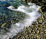 USA, Maine,  Waves breaking on a Rock Background