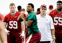 TALLAHASSEE, FLA.8/6/13-FSU080613CH-Florida State Head Coach Jimbo Fisher, right, watches quarterback Jameis Winston, center, as Ryan Hoefeld, left, and Jacobbi McDaniel, right, ready for the next drill during practice Aug. 6, 2013 in Tallahassee, Fla.<br /> <br /> COLIN HACKLEY PHOTO