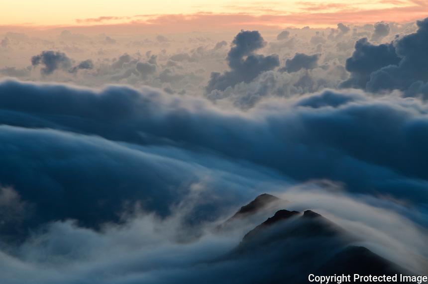 Hi winds at sunset on top of Haleakala Crater, Maui Hawaii.