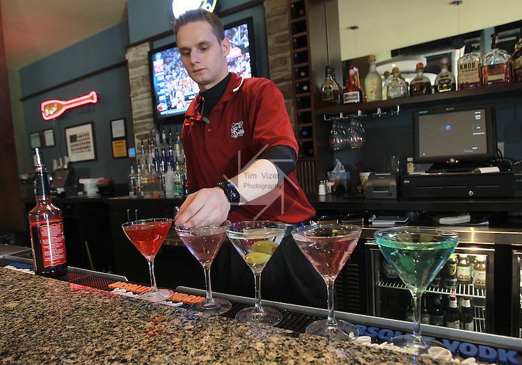 At the Edison's Entertainment Complex in Edwardsville, server Jeff Mundy of Edwardsville makes up a colorful variety of martinis.