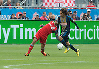 15 September 2012: Philadelphia Union midfielder/defender Gabriel Farfan #15 and Toronto FC midfielder Luis Silva #11 in action during an MLS game between the Philadelphia Union and Toronto FC at BMO Field in Toronto, Ontario Canada. .