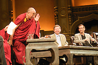 His holiness, the Dalai Lama, motions to his fellow laureates that he does not require a standing ovation during the 'Creativity and Well-being' discussion at the Orpheum Theater, Sept. 29, 2009, Vancouver BC. (Scott Alexander/pressphotointl.com)