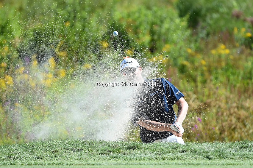 August 29, 2014 -  Norton, Mass. - John Senden hits his ball out of the sand trap on the 3rd hole during the first round of the PGA Deutsche Bank Championship held at the Tournament Players Club in Norton Massachusetts. Eric Canha/CSM
