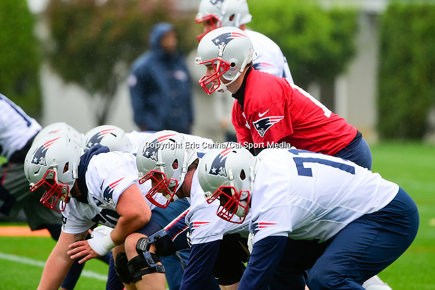 June 6, 2017: New England Patriots quarterback Tom Brady (12) (red) works behind the offensive line at the New England Patriots mini camp held on the practice field at Gillette Stadium, in Foxborough, Massachusetts. Eric Canha/CSM