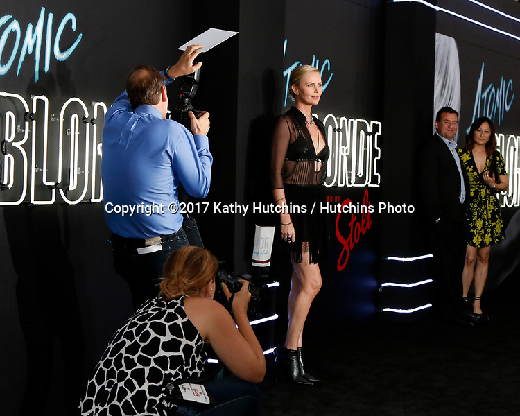 """LOS ANGELES - JUL 24:  Carpet photographers, Charlize Theron at the """"Atomic Blonde"""" Los Angeles Premiere at The Theatre at Ace Hotel on July 24, 2017 in Los Angeles, CA"""