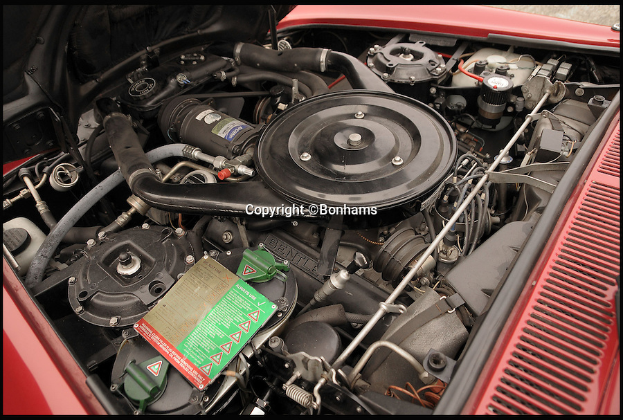 BNPS.co.uk (01202 558833)<br /> PIc: Bonhams/BNPS<br /> <br /> ***Please Use Full Byline***<br /> <br /> The engine of the 1985 Continental Bentley Convertible. <br /> <br /> The plush Bentley car that starred in the video for Elton John's cold war hit Nikita has emerged for sale for £70,000.<br /> <br /> The convertible red Bentley Continental took pride of place in the video for the 1985 hit single about a beautiful female Russian border guard called Nikita.<br /> <br /> The video featured Sir Elton sat in the luxury motor taking photos of Nikita from afar before making several failed attempts to drive it through her checkpoint.<br /> <br /> The Bentley is going under the hammer at auctioneers Bonhams in Paris on February 5.