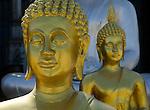 Two gold Sukhothai style Buddha statues