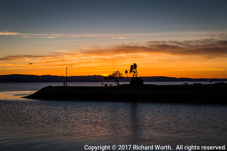 Sunset glows at the San Leandro Marina Park along San Francisco Bay on the Winter Solstice, 2017.