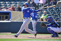 Round Rock Express infielder Patrick Kivelhan (18) swings against the Omaha Storm Chasers at Werner Park on April 12, 2016 in Omaha, Nebraska.  The Express won 6-4.  (Dennis Hubbard/Four Seam Images)
