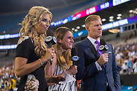 CHARLOTTE, NC - OCTOBER 3: Fox reporters Sara Walsh, Heather O'Reilly and Alexi Lalas stand on the sideline during a game between Korea Republic and USWNT at Bank of America Stadium on October 3, 2019 in Charlotte, North Carolina.