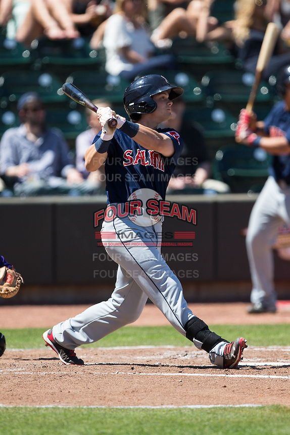 Andrew Benintendi (16) of the Salem Red Sox follows through on his swing against the Winston-Salem Dash at BB&T Ballpark on April 17, 2016 in Winston-Salem, North Carolina.  The Red Sox defeated the Dash 3-1.  (Brian Westerholt/Four Seam Images)