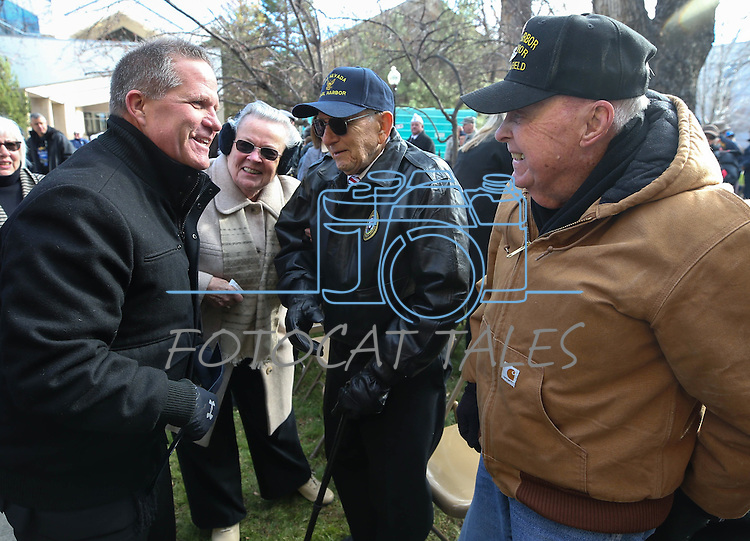 Nevada Lt. Gov. Mark Hutchison, left, greats Pearl Harbor survivors Del Schwichtenberg, left, and Robert Lloyd following the Pearl Harbor 75th Commemoration at the U.S.S. Nevada memorial at the Capitol in Carson City, Nev. on Wednesday, Dec. 7, 2016. <br /> Photo by Cathleen Allison/Nevada Photo Source