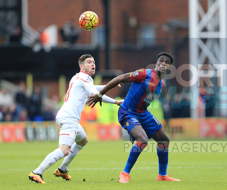 Crystal Palace's Wilfred Zaha tussles with Liverpool's Alberto Moreno<br /> <br /> - English Premier League - Crystal Palace vs Liverpool  - Selhurst Park - London - England - 6th March 2016 - Pic David Klein/Sportimage