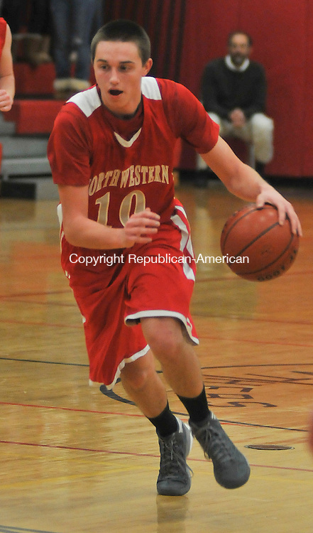 SOUTHBURY, CT 27 DECEMBER- 122712JS12 - ACTION MAN- Northwestern's John Stevens (10) pushes the ball up court during their game against Pomperaug Thursday at Pomeraug High School in Southbury. .Jim Shannon Republican American