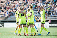 Seattle, WA - Sunday, April 17, 2016: Seattle Reign FC forward Merritt Mathias (9) celebrates her goal with teammates during the second half of the match at Memorial Stadium. Sky Blue FC defeated the Seattle Reign FC 2-1during a National Women's Soccer League (NWSL) match at Memorial Stadium.