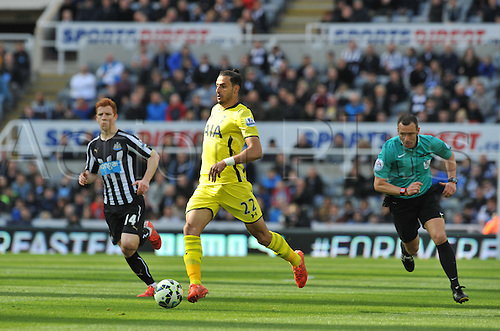 19.04.2015.  Newcastle, England. Barclays Premier League. Newcastle versus Tottenham Hotspur. Nacer Chadli of Tottenham Hotspur pushes forward past Jack Colback of Newcastle United before firing in the first goal