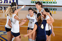 15 November 2008:  FIU's Natalia Valentin (9) and other teammates celebrate a point during the FIU victory 3-0 (25-14, 25-22, 25-20) over FAU at FIU Stadium in Miami, Florida.