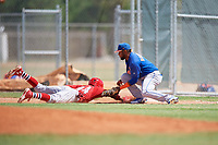 GCL Mets first baseman Anderson Bohorquez (1) puts a tag on Diomedes Del Rio (44) as he dives back towards first base on a pick off play during a game against the GCL Cardinals on August 6, 2018 at Roger Dean Chevrolet Stadium in Jupiter, Florida.  GCL Cardinals defeated GCL Mets 6-3.  (Mike Janes/Four Seam Images)