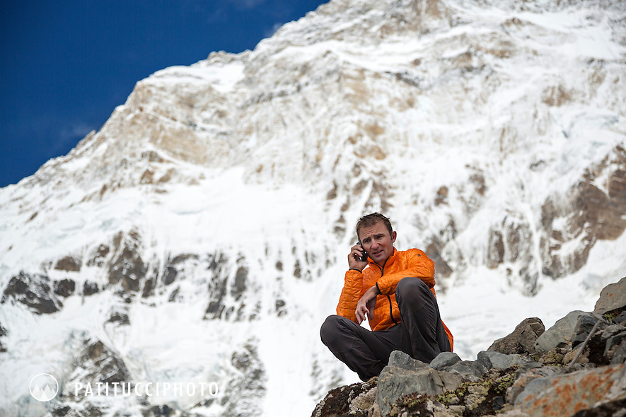 Ueli Steck returned to Nepal and the Annapurna south face in 2013 which he climbed solo, without oxygen, in one 28 hour alpine push, via a new route. The trip was his third attempt to climb the 8000 meter peak. Ueli using a satellite phone to call his wife and let her know he had climbed Annapurna immediately upon returning to advance basecamp.