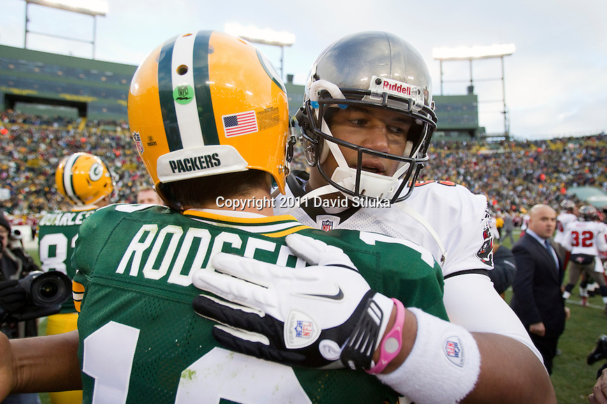 Green Bay Packers quarterback Aaron Rodgers (12) and Tampa Bay Buccaneers quarterback Josh Freeman (5) after a Week 11 NFL football game on November 20, 2011 in Green Bay, Wisconsin. The Packers won 35-26. (AP Photo/David Stluka)
